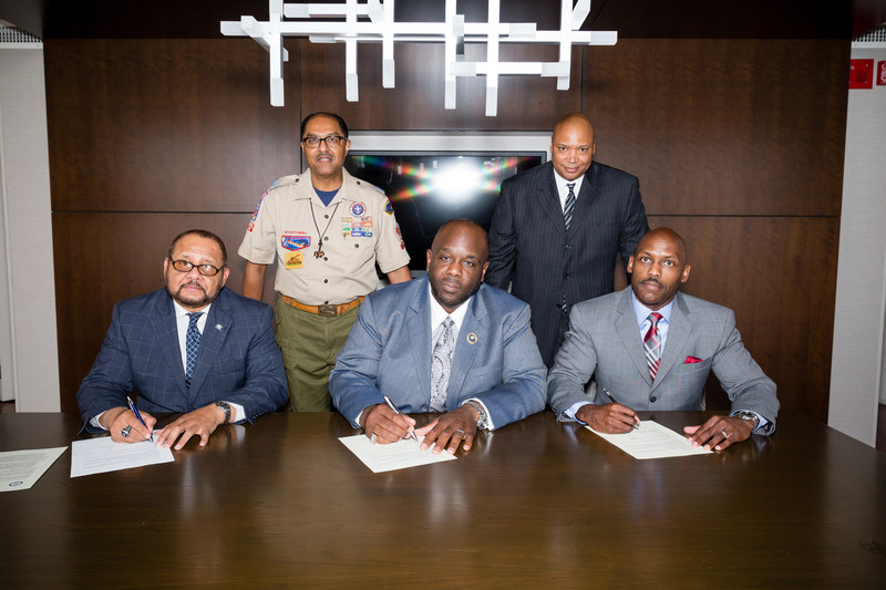 Shown in photo (left to right) SEATED: Arthur R. Thomas, Esq., 31st International President Phi Beta Sigma Fraternity, Inc.; Jonathan A. Mason, Sr., 34th International President Phi Beta Sigma Fraternity, Inc.; Lee Shaw, Jr., Director of National Alliances, Boy Scouts of America;  STANDING (left to right): William B. Covington, Assistant Council Commissioner, Northeast Illinois Council Boy Scouts of America and Keith Walton, Associate National Director Boy Scouts of America (PRNewsfoto/Phi Beta Sigma Fraternity, Inc.)